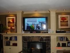 Custom built-in cabinets and shelving in entertainment centre
