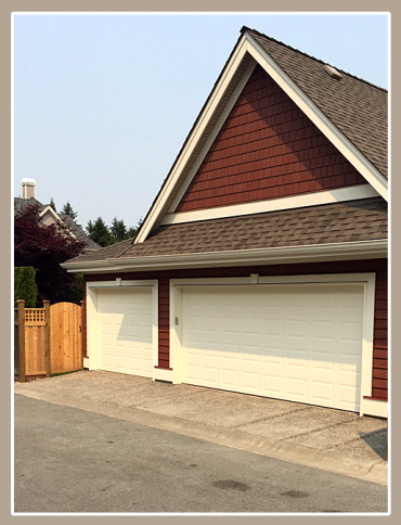 Seamless single-car garage addition, including new fencing; new exposed aggregate driveway.